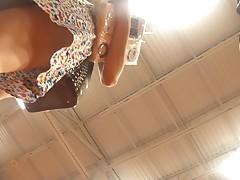 Hot Brunette Upskirted While Shopping