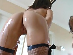 Oiled Up Brunette Fishnet Stocking Masturbation