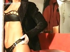 Beautiful Mistress With Big Tits Wearing Leather Tong And..
