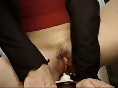 Brunette gives herself a sybian orgasm
