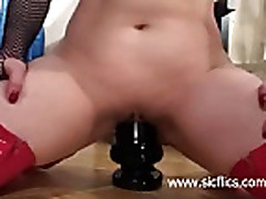 Two huge dildos stuffed in her loose gaping pussy