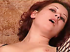 Amateur redhead in fishnet rides a fucking machine
