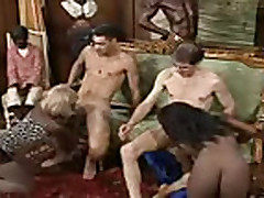 Two black girls sharing two white cocks