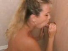 Busty Babe Sucks Cock through Glory Hole