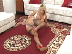 Sexy blonde in stockigns