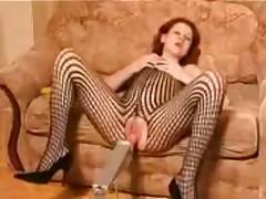 Sexy redhead rides a fucking machin