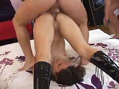 Petite minx wearing leather boots gets ganged on