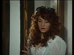 Two curly hair retro girls blow the guy
