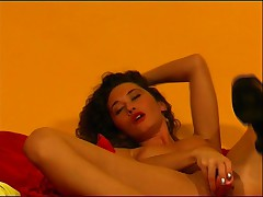 Curly Brunette undresses and plays 2