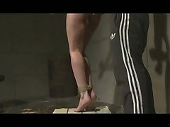 Tied up babe gets hot wax and pussy pump