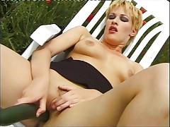 GTI slut masturbates outdoor 1