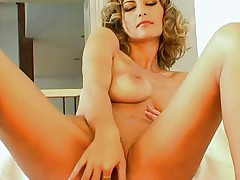 Glamour blonde stripping & masturbating