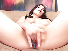 Brunette Latina stretching her pink taco