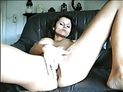 Brunette fingered on couch