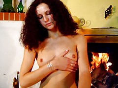 Andrea stripping beside chimney
