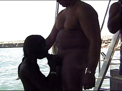 Ebony babe vaginal workout on the water