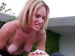 Lesbians by the pool dildoing