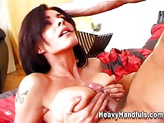 Cumshot between Luisa Rossellini's tits