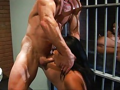 Latina in prison cell with bodybuilder