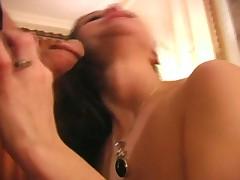 Classy looking hottie enjoys sucking on cock
