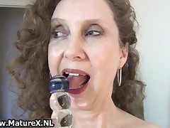 Dirty Mature Lady Loves To Stuff Her Own Tight Pussy With A Big Glass Dildo By MatureX