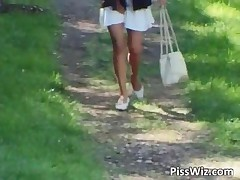 Weird And Strange Scene Where Lovely Chick Raises Her Skirt And Pisses Through Panties In Nature By