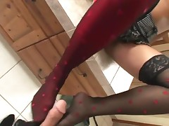 Kinky Footjob In Red And Black Stockings