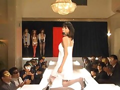 Asian Models In Sexy Outfits Posing On Catwalk