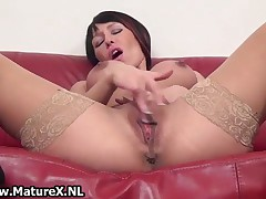 Mature Lady With Big Fake Tits Loves To Please Her Own Wet Pussy By MatureX