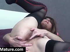 Excited Mom In Stockings Fingers Her Asshole