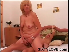 Mature Harlot Riding A Thick Young Prick