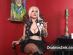 Rock Star Blonde Loves To Show Her Big Tit Cleavage In This Porn Video By DiablosInk