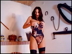 Busty Brunette In A Panties And Stockings Stripping And Teasing You