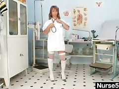 Amateur Wife Wearing Nurse Uniform And Stocking And Pump Boots She Sits On Gyno Chair And Performs K