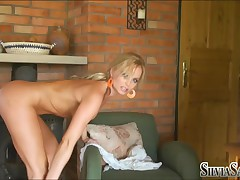 Silvia Saint - Silvia Stripping Beside A Wood Stove
