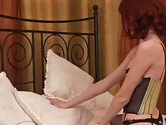 Cute redhead plays with her dildo