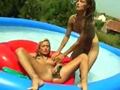 Skinny lesbian teens dildo in the pool