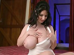 Playing with her huge beautiful shiny natural tits