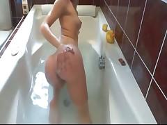 Brunette solo in tub