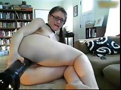 Teen in High Heels rides big Anal Dildos