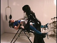 Mistress Jean Ties Up Latex Slaves