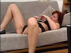 MILF working with her dildo