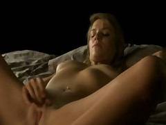 Young blonde pleasures herself