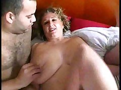 Big busty blond chick on bed