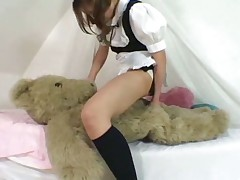 Young japanese girl play with her Teddy bear