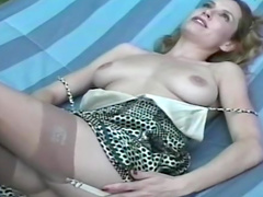 Gorgeous nylons model masturbates  solo