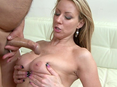 Sexy blonde is being covered with thick cum