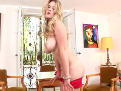 Curly busty blonde Brookie G is posing naked