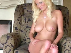 Alluring blonde Hanna Hilton is sitting with spread legs