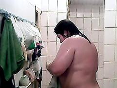 Voyeur scene with a big chubby brunette